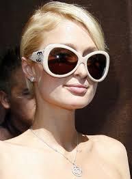 http://tbn1.google.com/images?q=tbn:ktclMEfPJVjUcM:http://www.splendicity.com/files/643/2008/05/paris-hilton-sunglasses-nc.jpg